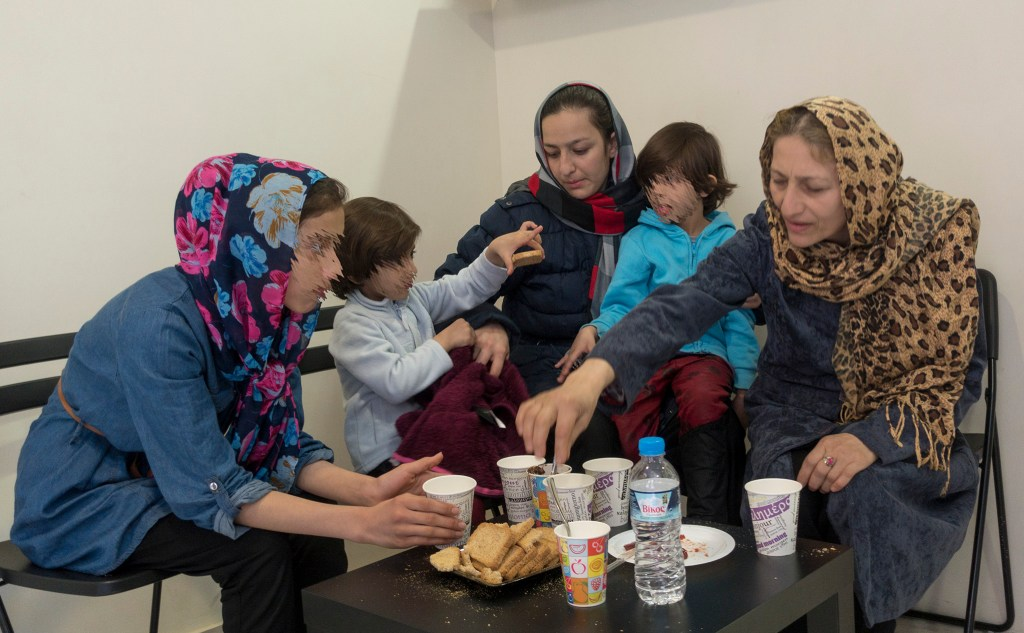 A family from Afghanistan resting at the center
