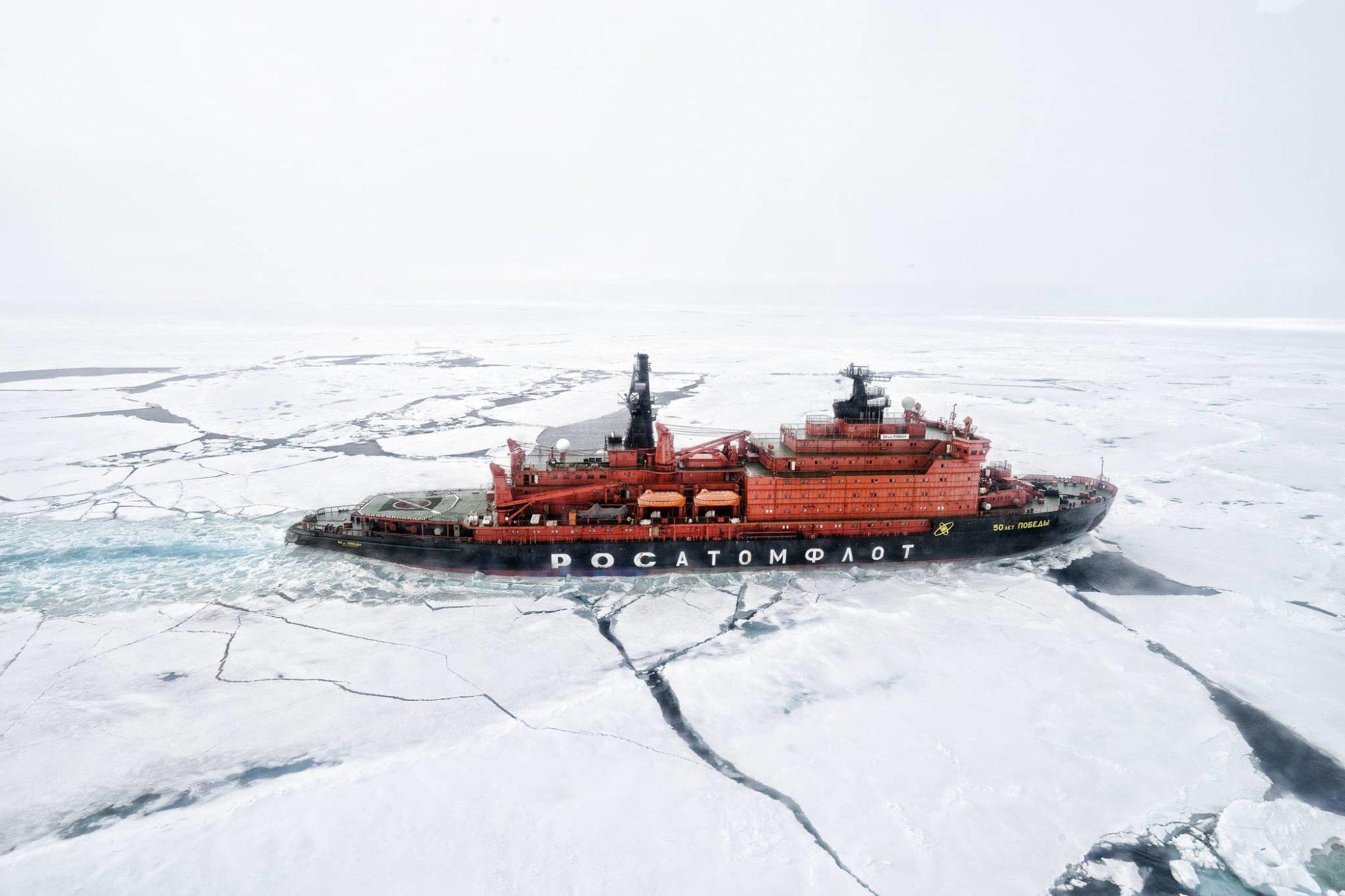 A ship traverses through Arctic ice caps; Arctic maritime