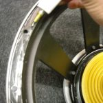 12) apply glue to speaker frame where cone will sit