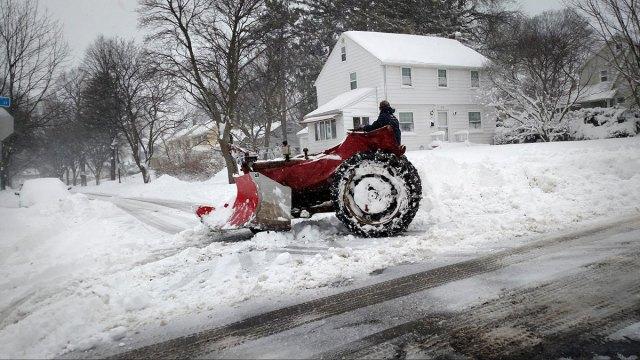 Winter sidewalk snowplow. Rochester NY.