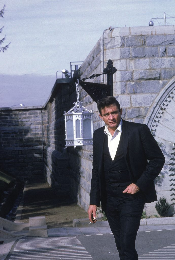 "Country singer Johnny Cash poses outside the Folsom Prison in California on January 13, 1968, the day he recorded his live album ""Johnny Cash at Folsom Prison."" (AP Photo/Dan Poush)"