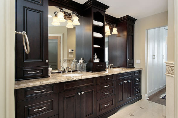 elegant double vanities with closed and open upper storage in walnut with beatiful bathroom hardware