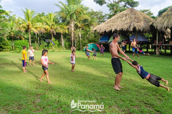 Playing with the children, they literally lined up to be turned around at Emberá Majé Cordillera
