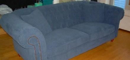 reupholstered blue couch with padded back