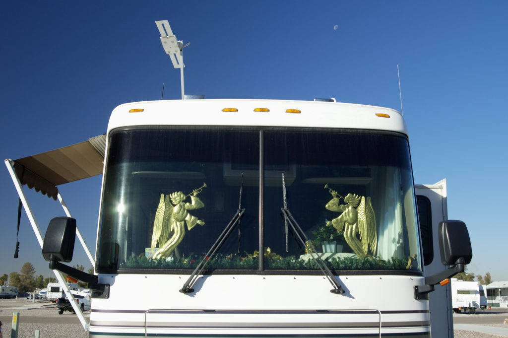 RVing during the holidays doesn't mean you have to stop decorating. A Utah RV dealer shows two angels in the windshield of a motorhome.