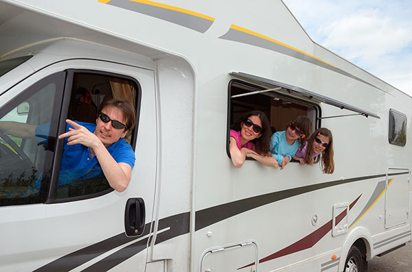 Family happily travelling in their RV during warmer months.
