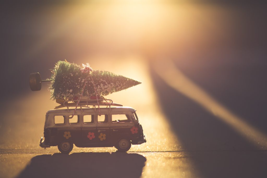A small ornament of a VW style bus with a Christmas tree on top!