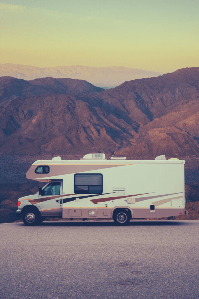 Image of a used motorhome in front of Utah mountains, used for RV repair blog.
