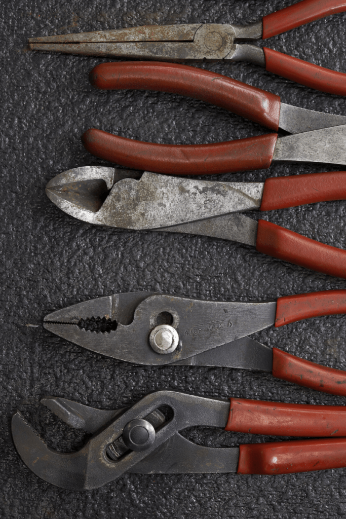 Picture of used red handled plier set