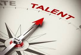 """Returning employees - compass pointing north at the word """"talent"""""""