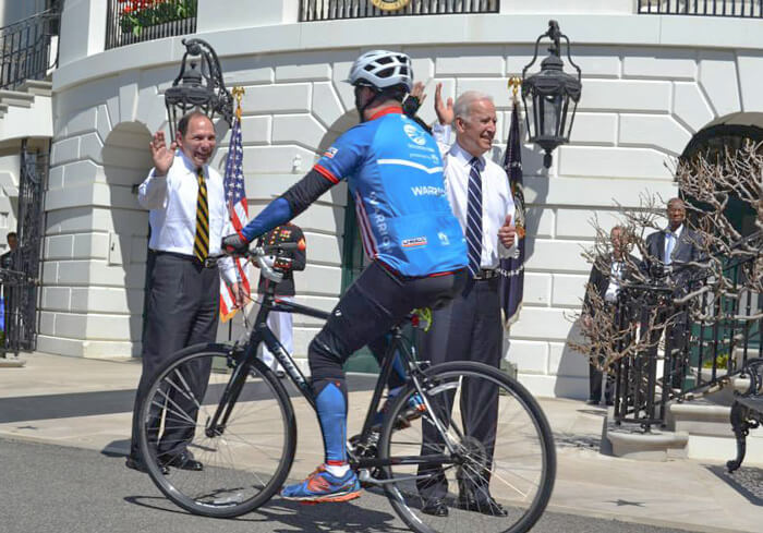 US Soldier riding past Biden & McDonald
