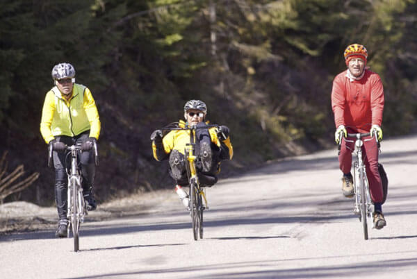 Three-cyclists-riding-on-road