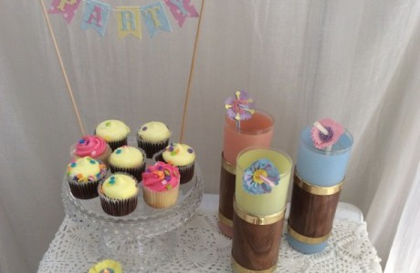 Embellish tea lights, straws and party banner with rolled paper flowers