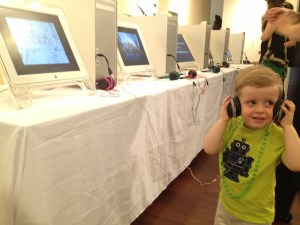 Thanks to Merrill College of Journalism Lecturer and PhotoJournalist Bethany Swain for this great pic of a young visitor enjoying the Critical Exposure reception this past week. All the Mac PPC towers and monitors were donated by MRC.