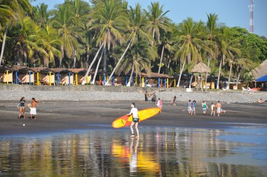 Karen coming back from surfing at Sunzal Point, Playa El Tunco, El Salvador