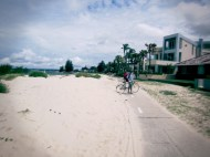 riding next to sand dunes