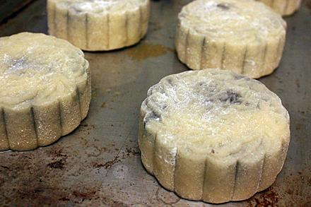 Uncooked mooncake on baking sheet