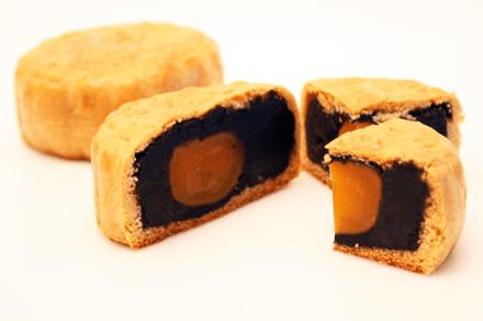 Black sesame and salted yolk mooncakes