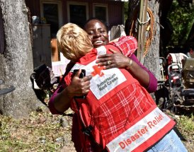 "High winds from Hurricane Matthew brought down huge trees all around Shanta Millan's home on Edisto Island, but her home survived intact. ""Yes, we have storm damage, but we know how lucky we really are in life,"" said Shanta as she gave Red Cross disaster responder Michelle Hankes big hug. Photo Credit: Bob Wallace/American Red Cross"