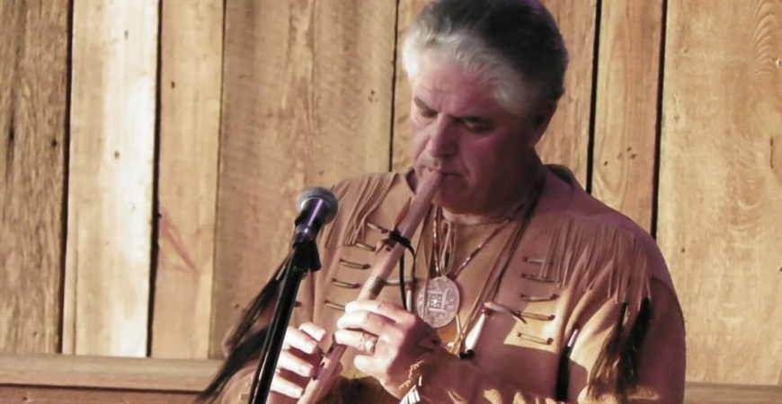 Native Randy McGinnis playing the Flute