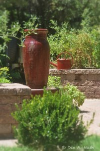 Red fountain and potager with Haws watering can.