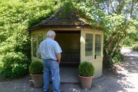 Bill studying the potting shed for ideas. I'd like to have a shed like this to keep my tools handy.