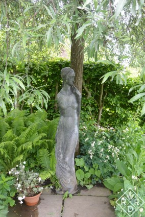 The famous statue under the weeping pear tree.