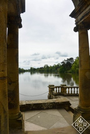 Gazing out upon the lake at Hever Castle from beneath the columns.