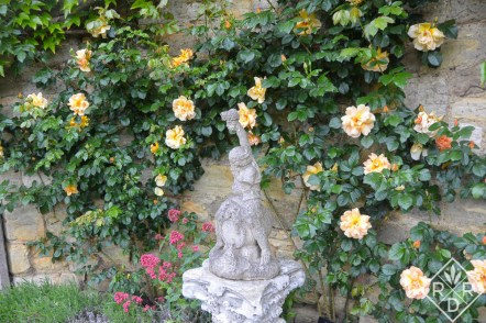 A fountain at the Italian Gardens at Hever Castle that looks out upon the lake.