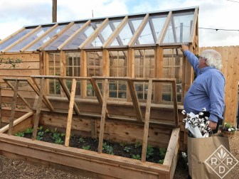 Bill talking with other customer about the single pane glass in the greenhouse.