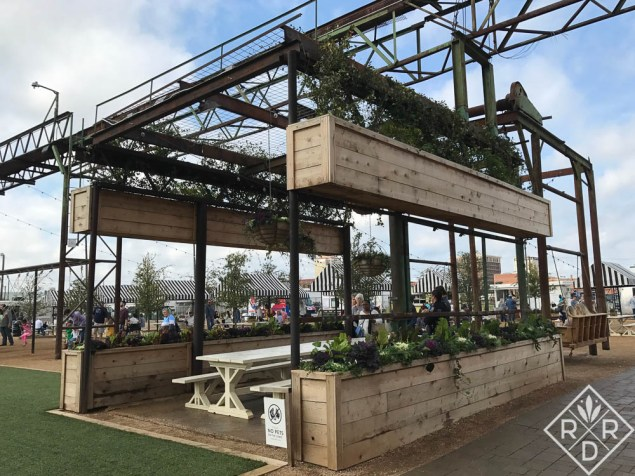 Raised beds and picnic table for outside snacking at Magnolia Market.