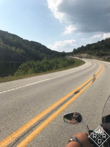 The open road from a motorcycle. Tooling around Eureka Springs, AR.