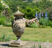 The urn standing proudly in front of the herbaceous border.