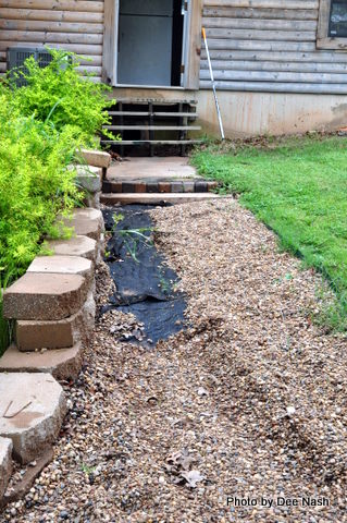 Washed out gravel path will be rebuilt in brick