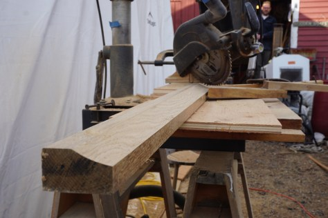 the shape of the molded sheer profile is roughed out with a radial arm saw on an angle and a quarter round router bit on the top.