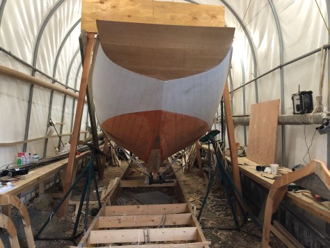 Here the boat is upright with jack stands ready to be set but no blocks under the keel yet.