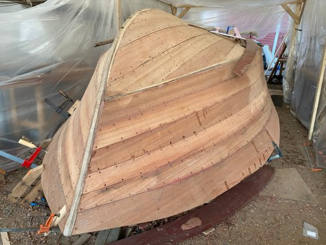 Once topsides planking was done, rough fairing started and any screws too close to the surface were re-set.