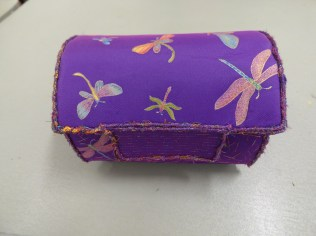 An embroidered box by Di