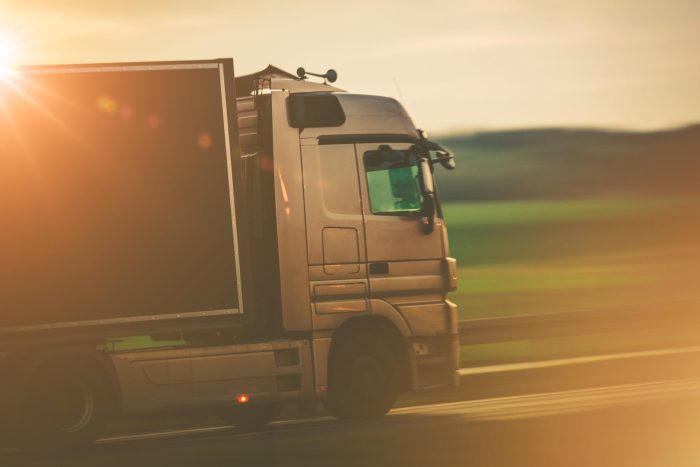 Road Transportation by Truck Concept Photo. Speeding Euro Truck on the European Highway.