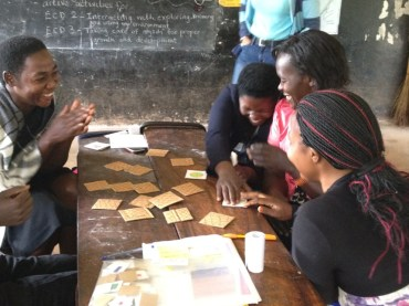 Having fun playing dice games which could be used with children. These teachers are unused to playing games – they had a great time with a game of pairs.
