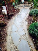 newly constructed slate path with beach stone infill