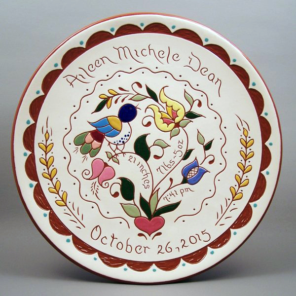 # 22-10 in. Birth Plate - with Pennsylvania Dutch design. $49