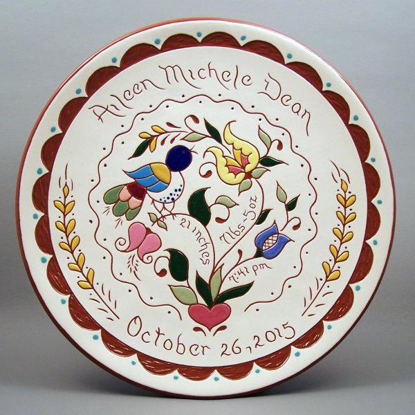 # 22-10 in. Birth Plate - with Pennsylvania Dutch design. $49
