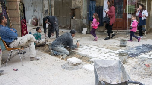 Workers in the Arab district repairing street stones