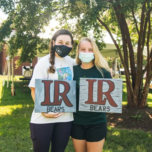 "Two students show ""LR Bears"" signs they painted"