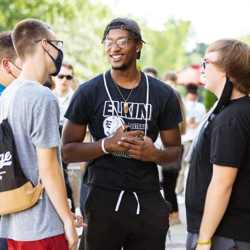 Three students talking during new student orientation