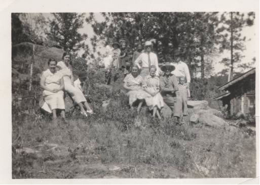 "A lovely summer day in Red Feather Lakes – the Moore family next to the ""Pawnee"" Cabin"