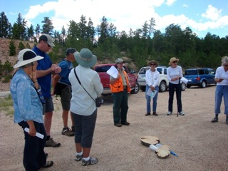 Marcy talking about Dendrochrononology & culturally modified trees to tour participants