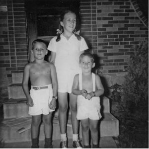 Judith, John and Bill Stenzel in front of their Kansas City home in 1949.