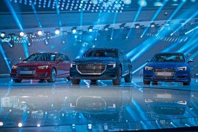 Audi A4 2.0 T quattro , Audi e-tron quattro concept, Audi A4 2.0 TDI at the International Auto Show 2015 in Frankfurt.